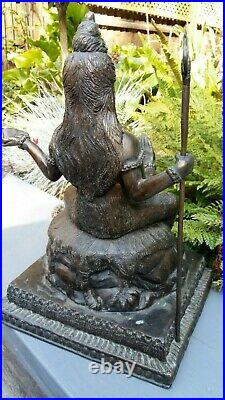 Asian bronze statue heavy well made item with staff in hand nice item
